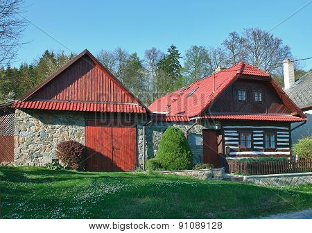 Classic czech wooden house in sunny day