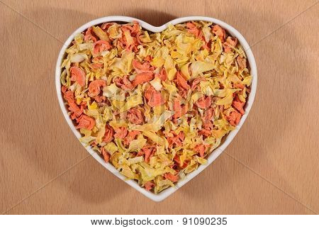 Dried Carrots And Onions In Plate In Form Of Heart