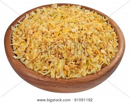Dried Onions In A Wooden Bowl On A White