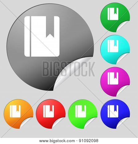 Book Bookmark  Icon Sign. Set Of Eight Multi-colored Round Buttons, Stickers. Vector