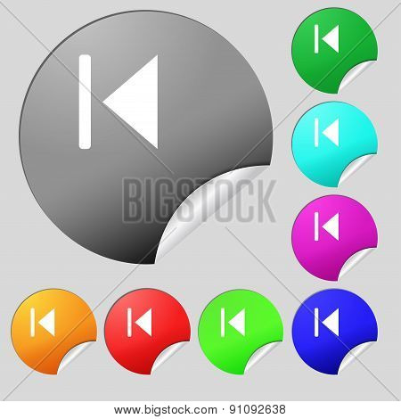 Fast Backward  Icon Sign. Set Of Eight Multi-colored Round Buttons, Stickers. Vector