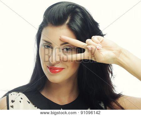 Funny woman doing hand sign. Studio shot.
