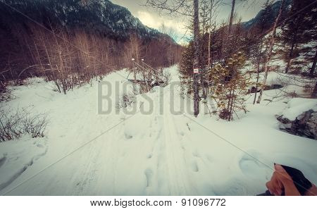 Winter road to footbridge