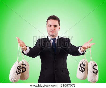 Man with money sacks on white