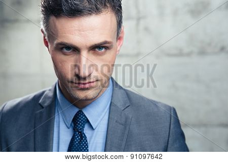 Closeup portrait of a confident businessman looking at camera