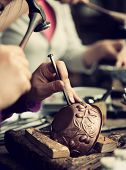foto of copper  - Copper master hands detail of craftsman at work - JPG