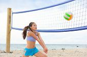 image of beach-ball  - Beach volleyball woman playing game hitting forearm pass volley ball during match on summer beach - JPG