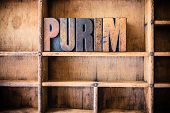 stock photo of rabbi  - The word PURIM written in vintage wooden letterpress type in a wooden type drawer - JPG