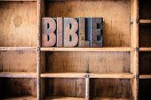 stock photo of bible verses  - The word BIBLE written in vintage wooden letterpress type in a wooden type drawer - JPG
