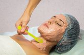 pic of facials  - Beautiful woman with facial mask at beauty salon - JPG