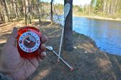 foto of compass  - With compass on spring river - JPG