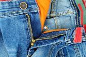 foto of zipper  - Zipper detail of pants in jeans for men light blue color - JPG