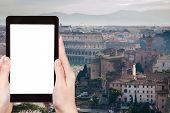 Постер, плакат: Tourist Photographs Ancient Coliseum In Rome