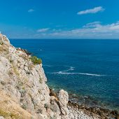 foto of crimea  - Wild Black sea shore at spring season Cape Martyan Crimea - JPG