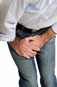 stock photo of crotch  - Close up on a man covering his painful crotch - JPG