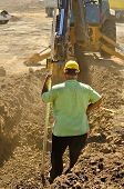 pic of street-rod  - Construction excavation contractor uses a level rod and laser to dig a trench for a concrete fondation wall