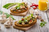 picture of sprinkling  - Toast with mushrooms and fried chicken sprinkled with fresh herbs little spicy from garlic and chilli fresh juice - JPG
