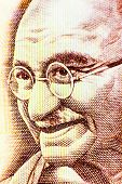 picture of indian  - Closeup macro view of Mahatma Gandhi on an Indian currency note - JPG