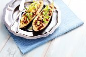 stock photo of aubergines  - stuffed aubergines with minced meat tomatoes and feta cheese  - JPG