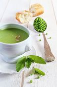 foto of pea  - Minty Pea Soup mint leaves peas in a large vintage spoon on a light background - JPG