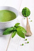 pic of pea  - Minty Pea Soup mint leaves peas in a large vintage spoon on a light background - JPG