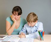 pic of homework  - The mother helping his son to do homework - JPG