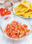 foto of nachos  - Bowl of fresh homemade salsa and nachos - JPG