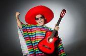foto of sombrero  - Man in red sombrero playing guitar - JPG
