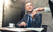 stock photo of waiter  - Handsome man giving bank card to waiter in cafe - JPG