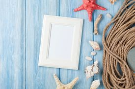 image of shell-fishes  - Summer time sea vacation with blank photo frame - JPG