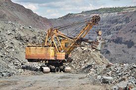stock photo of iron ore  - Excavator on the iron ore opencast mining - JPG