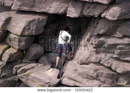 Female Climber ascending the 'Old Man of Stoer'