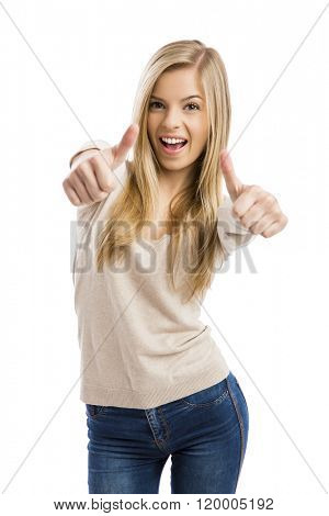 Beautiful and happy teenage girl with thumbs up, isolated over white background