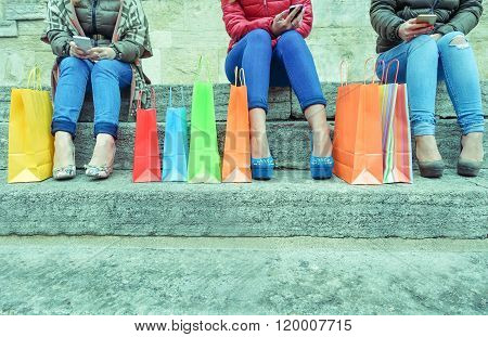 Happy Young Women With Smartphones Testing Online After Shopping - Fashion Girls Sitting On Stairs W