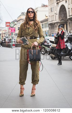 MILAN, ITALY - FEBRUARY 25, 2016: Fashionable woman poses outside Luisa Beccaria fashion show building during Milan Women's Fashion Week