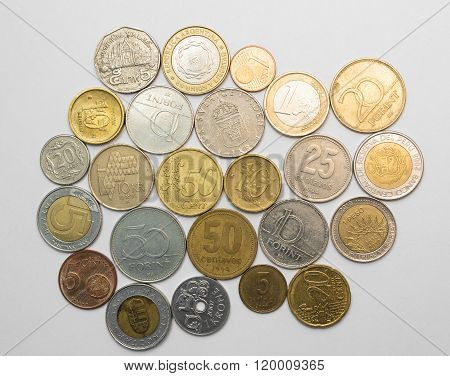Collection Of Coins From Different Countries Isolated On White