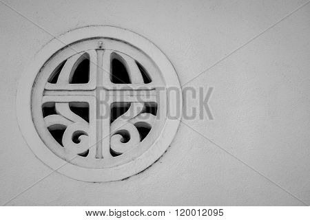 Round ornate concrete window of St. Augustine By-the-Sea church