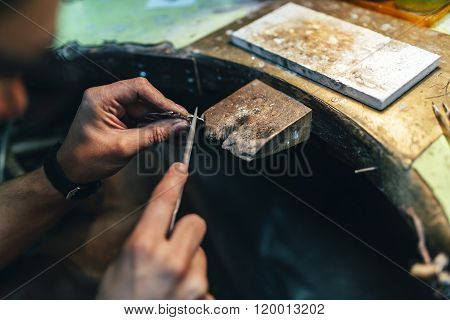 Jeweler crafting jewelry on his workbench work