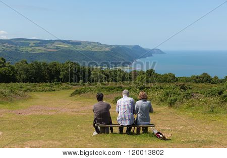 Walkers enjoying a rest view of Porpock bay Selworthy Beacon Somerset