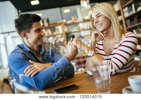 Beautiful couple in love flirting in restaurant and bonding