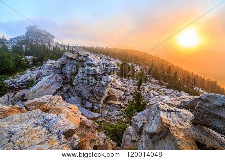 sunrise on the top of mountain, the top of ridge, ridge in forest, russian nature