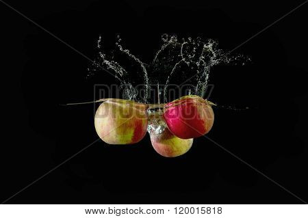 Red Apples Fell Into The Water