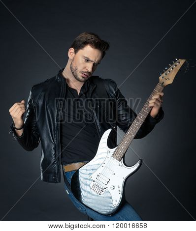 handsome man playing the guitar