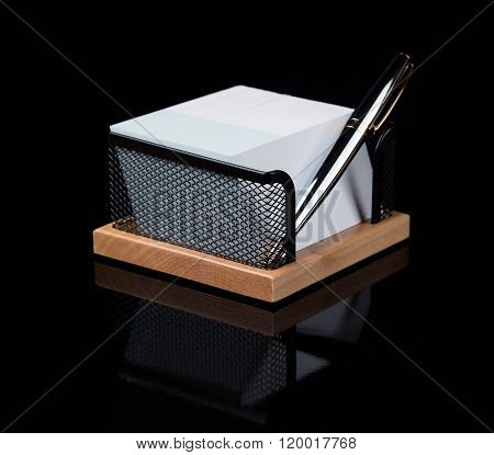 wooden stationery set with silver pen isolated on a dark background ** Note: Shallow depth of field