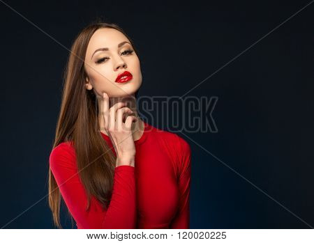Attractive woman standing on black background