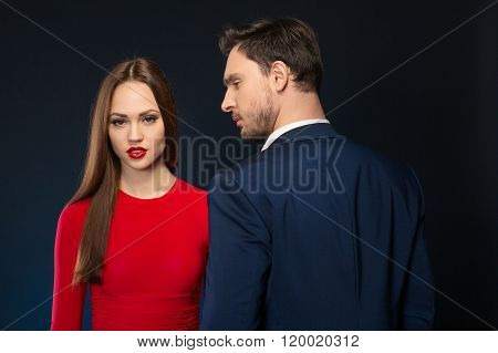 Handsome man looking at  attractive woman