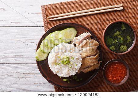 Hainanese Chicken Rice, Chilli Sauce And Bouillon. Horizontal Top View
