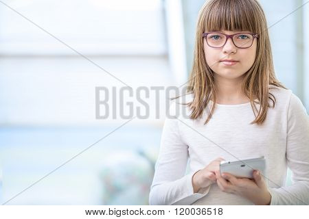 Young of beautiful pre-teen girl with tablet laptop pc. Education technology for teenagers