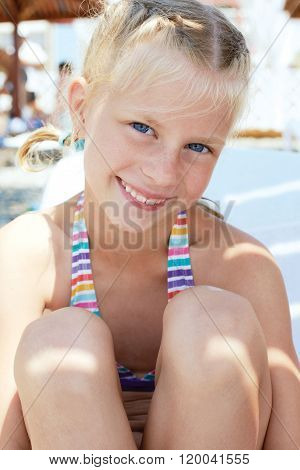 Portrait Of A Little Girl Vacationers In A Sunny Summer Day