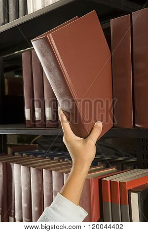 Female student reaching for a book